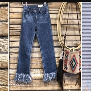 Stretchy frayed mid-rise denim jeans